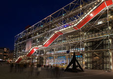 The Pompidou Centre, Paris, at night. Crowds flocking towards the steel structure of the Pompidou Centre at night. Motion blur on the people, nobody is Stock Photo