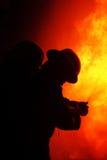 Pompier au feu Images stock
