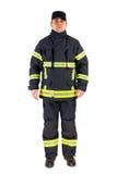 Pompier dans l'uniforme d'isolement dans le blanc images libres de droits