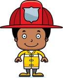 Pompiere sorridente Boy del fumetto Immagine Stock Libera da Diritti
