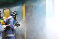 Pompieri che si preparano sulla base Immagini Stock Libere da Diritti
