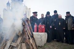 Pompieri e sacerdoti Fotografie Stock