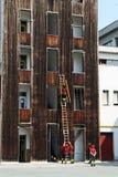 Pompieri in una caserma dei pompieri Immagine Stock Libera da Diritti