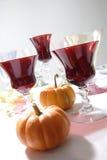 Pompoenen met Rood Glas Stock Foto's