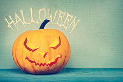 Pompoenlantaarn met Halloween-groet Stock Foto