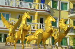Pompous glossy decoration. Golden unicorns in front of pretentious facade in Bulgarian summer resort Elenite stock image