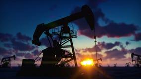 Pompowej dźwigarki przemysłowa maszyna dla rop naftowych w wschód słońca Sylwetka pompowa dźwigarka pompuje olej przeciw czerwone zbiory