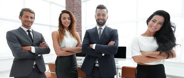Pomyślna biznes drużyna w tle biuro zdjęcie royalty free