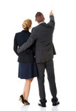 Pomyślna biznesowa para wskazuje daleko od Zdjęcie Stock