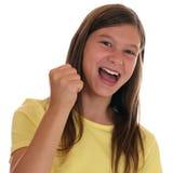 Pomyślna dziewczyna zaciska pięść gdy wygrywający obrazy stock