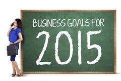 Pomyślna kobieta z biznesowych celów deską Zdjęcia Stock
