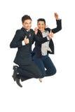 Pomyślni ludzie biznesu skaczą Obraz Royalty Free