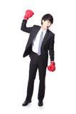 Pomyślny biznesmen z bokserskimi rękawiczkami Obraz Royalty Free