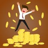 Pomyślny biznesmena doskakiwanie na złocistych monetach Zdjęcie Royalty Free