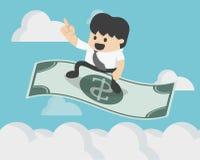 Pomyślny biznesmena obsiadanie na latającej dolarowej magii Zdjęcia Stock
