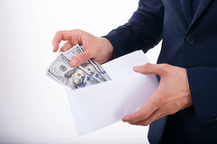 Pomyślny młody biznesmen chuje jego savings Obraz Stock