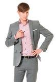 Pomyślny młody biznesmen w kostiumu fotografia stock