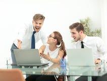 Pomyślna biznes drużyna z rękami up przy biurem Zdjęcie Royalty Free