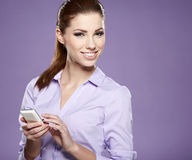 pomyślny bizneswoman z telefon komórkowy. Obraz Royalty Free