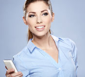 Pomyślny bizneswoman z telefon komórkowy. Obrazy Royalty Free