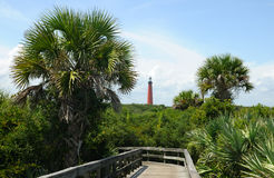 Ponce Lighthouse. With lush, green foliage as seen from the hiking path and boardwalk at New Smyrna Beach, Florida Stock Images