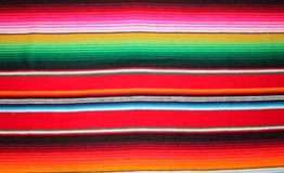 Poncho Mexican cinco de mayo rug serape fiesta traditional Mexico background with stripes copy space maya blanket minimal simple