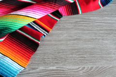 Poncho background Mexican serape Mexico cinco de mayo fiesta wooden copy space.  Royalty Free Stock Photo