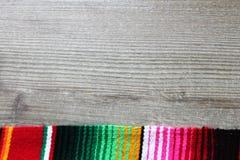Poncho serape background Mexican cinco de mayo fiesta wooden copy space Royalty Free Stock Photo