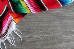 Poncho serape background Mexican cinco de mayo fiesta wooden copy space Stock Photo