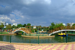 Pond in а park and storm clouds Stock Image