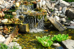 Pond. Natural stone pond as landscaping design element Royalty Free Stock Image