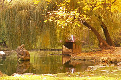 Pond. With statue in autumn Royalty Free Stock Photos