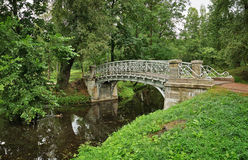 Pond with ancient  bridge in Gatchina Stock Images