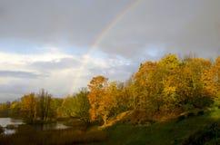 Pond in autumn and rainbow Stock Photos