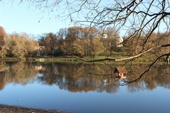 Pond, in the background palaces, in the foreground bird feeder. Russia. Moscow. Park Tsaritsyno. Autumn. Pond, in the background palaces, in the foreground bird Stock Image