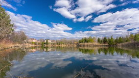 Pond and blue sky with clouds stock video footage