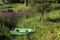 Pond with boat Royalty Free Stock Images