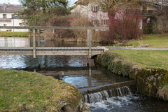 Pond with bridge and cascade in Bavaria Royalty Free Stock Images