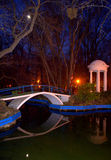 Pond,bridge,colonnade and moon in the evening Royalty Free Stock Photos