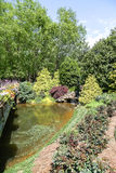 Pond by Bridge in Landscaped Garden Royalty Free Stock Image