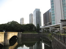 Pond with bridge near public garden in the central part of Tokyo city Stock Image