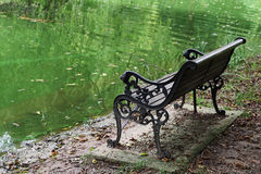 Pond and chair. Of the pond next to the rest of the chair stock image
