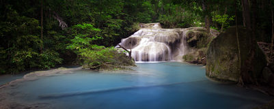 Pond with clear blue water and waterfall in Thailand rainforest Royalty Free Stock Images