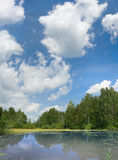Pond and clouds on blue sky Royalty Free Stock Images