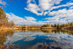Pond and cloudy sky Royalty Free Stock Photos