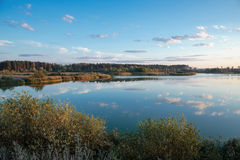 Pond in countryside in autumn at sunset Stock Image