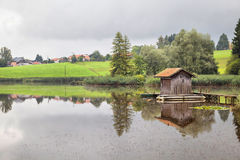 A pond with a fischer hut Stock Image