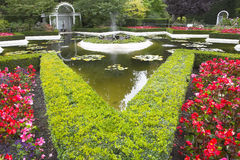 Pond, flower bed and fountain. Royalty Free Stock Image