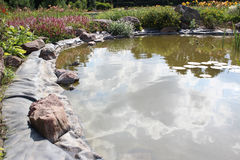 Pond and flower bed Stock Images