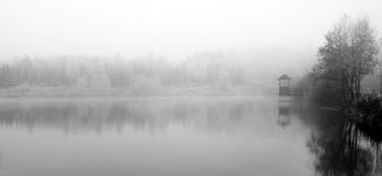 Pond in fog. Autumn melancholy picture pond in fog Royalty Free Stock Images